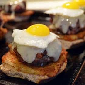 Serving of corned beef hash with quail eggs