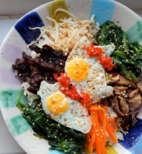 Fresh quail egg Bibimbap served on a plate