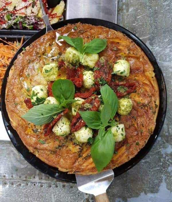 An Italian quail egg frittata with pesto and goat cheese