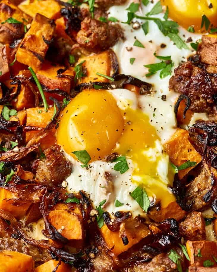 Sweet Potato Hash With Quail Eggs, Sausage And Caramelized Onions
